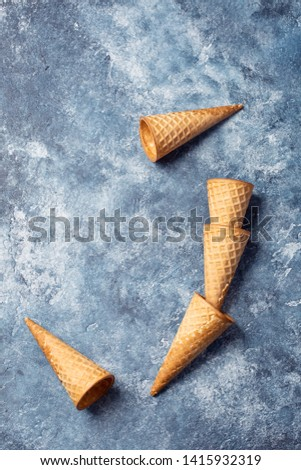 yellow ice cream waffle cones on blue background #1415932319