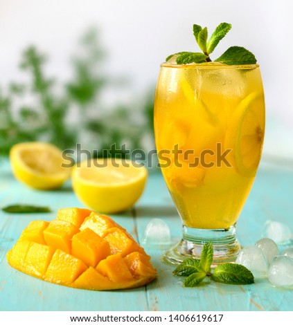 Yellow iced tea with pineapple, lemon #1406619617