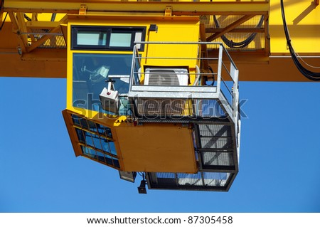 Yellow industrial crane cab