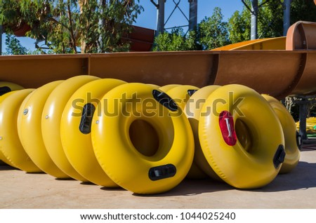 Yellow inflatable wheels for high-speed descent from the slides, water park, Hurghada, Egypt   #1044025240