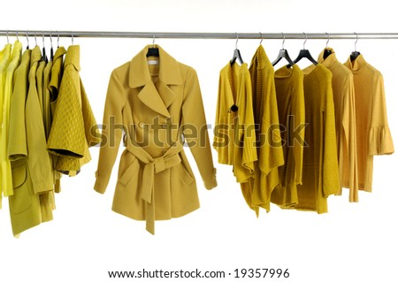 Yellow jacket on Hangers - stock photo
