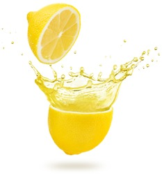 yellow juice splashing out of a lemon isolated on white