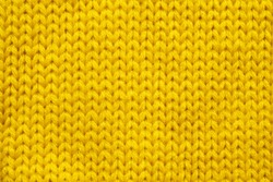 Yellow knitting wool texture background
