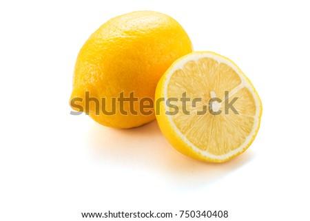Yellow lemon citrus fruit with lemon fruit half isolated on white background with clipping path