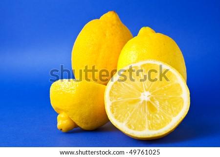 Yellow lemons isolated on blue background