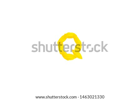 Yellow letter Q from sunflower petals fonts,  alphabet element, beauty decorative  font isolate of a white background close-up #1463021330