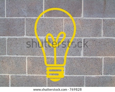 YELLOW LIGHT BULB ON CINDER BLOCK WALL