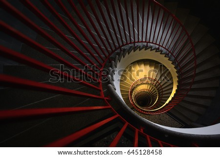 Yellow light in the center of spiral staircase