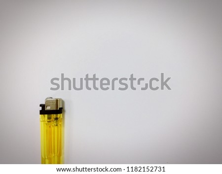 Yellow lighter On a white background #1182152731
