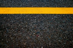 Yellow line in road texture background, Dark tone style.