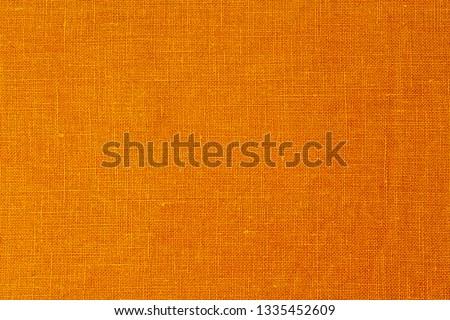 Yellow linen cloth texture. Wrinkled ochre pure linen fabric background. Natural yellow linen texture