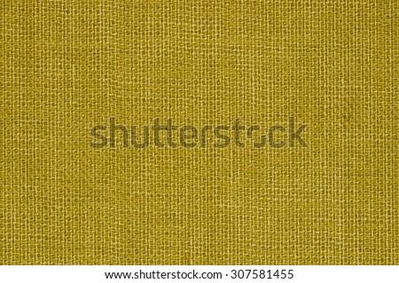 Yellow linen texture closeup photo background.