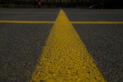 yellow lines in the big black asphalt international way, asphalt parking area, car park