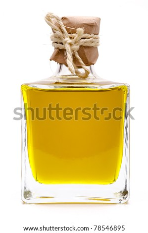Yellow liquid, olive oil, in a small glass bottle, traditional rustic style