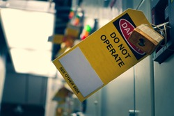 Yellow Lock out & Tag out for Lock station,machine - specific or switch gear roomd evices and safety first point, Cyber security or safety industrial concept.
