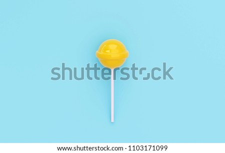 yellow lolipop on blue pastel background. sweet candy concept