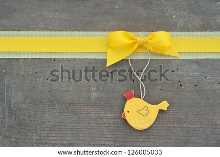 yellow loop and hen on wooden ground/easter/hen