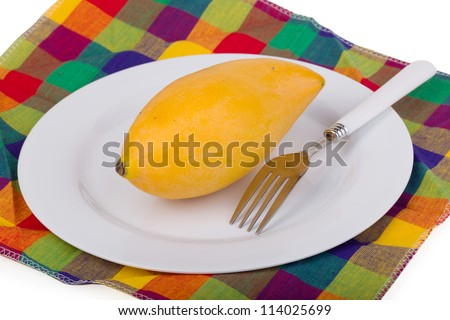 Yellow Mango In The Plate On Colored Table Linen With Fork Stock ...