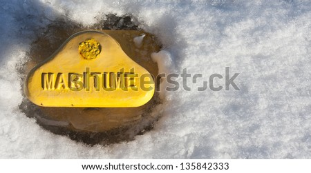 Yellow maritime bollard in snow at winter #135842333