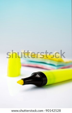 Yellow marker with a stickers on a background