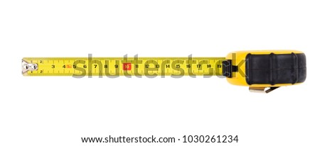 Yellow measuring tape isolated cut out on white background, top view