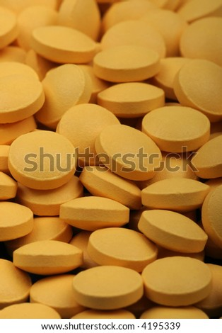 Yellow medical pills