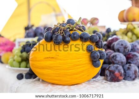 Yellow melon and grapes, Autumn fresh fruit #1006717921