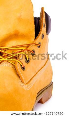 Yellow men's boots isolated on white background