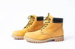 Yellow men's work boots from natural nubuck leather isolated on white background. Trendy casual shoes, youth style. Concept of advertising autumn winter shoes, sale, shop