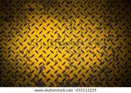 yellow metal sheet with dark...