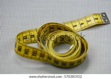 yellow meters from tailoring Imagine de stoc ©