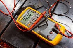 Yellow Multimeter, A multimeter or a multitester is an electronic measuring instrument. A typical multimeter can measure voltage, current, and resistance.