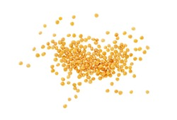 Yellow mustard seeds isolated on white background, top view