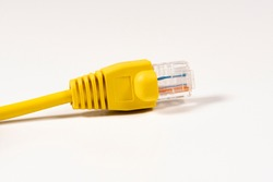 Yellow Network Cable with molded RJ45 plug isolated against white background.