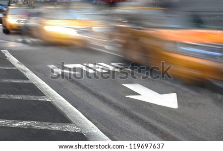 Yellow New York taxi cabs in blurred motion