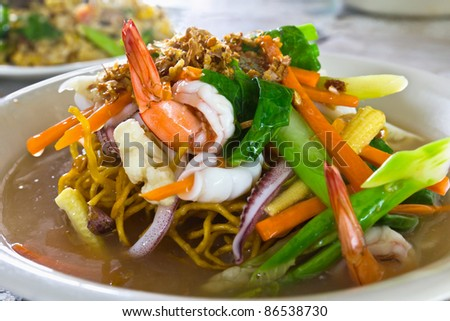 Yellow noodle seafood shrimp and squid  in Chinese style food