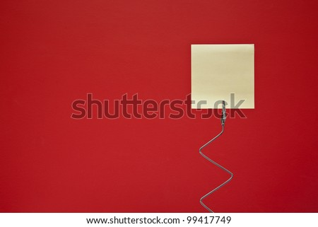 Yellow note on red background