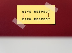Yellow note on red copy space background written GIVE RESPECT EARN RESPECT , mean respect is earned or received by giving it to others ,everyone deserves to be respected, two ways street interaction