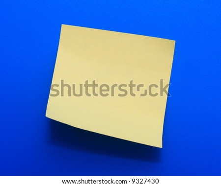 Yellow note paper on a blue background - stock photo