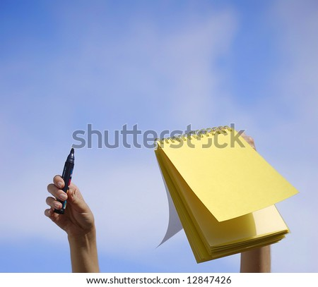 Yellow notebook in a blue sky
