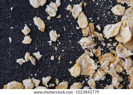 Yellow oats pyramid positioned in the corner on a black stone background