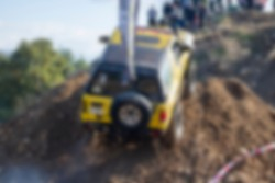 Yellow offroad car blurred unfocused background in forest.