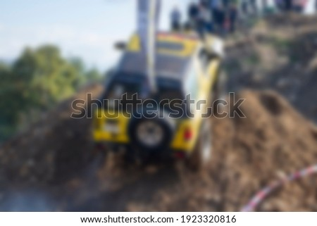 Yellow offroad car blurred unfocused background in forest. Stock photo ©