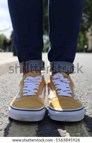 Yellow on Yellow. Yellow street lines and Yellow vans #1563845926