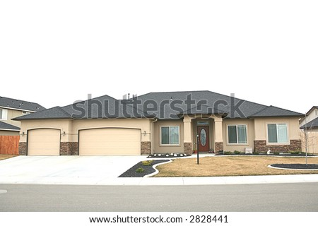 Yellow one level home with three car garage