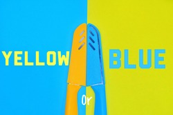 Yellow Or Blue Wording and A Pair Of Plastic Covered Knife, Isolated With Blue and Yellow Background