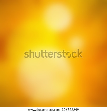 yellow orange hot background image, vibrant glowing yellow orange and white bokeh lights blurred in foreground, artsy classy bright abstract background