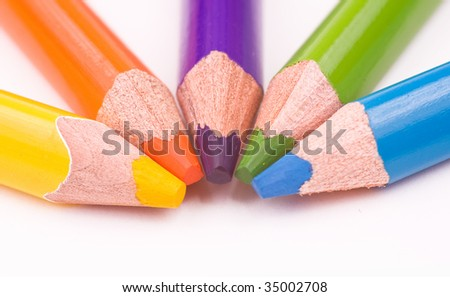 Yellow, orange, violet, green, blue pencils