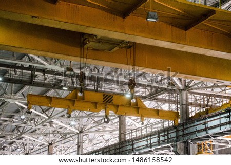 Yellow overhead crane. Jib crab trolley with hooks and linear traverse. #1486158542