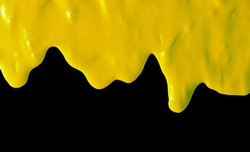 Yellow paint isolated on a black background.